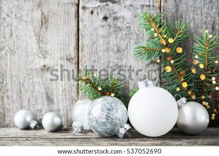 Silver And White Christmas Ornaments Xmas Tree On Rustic Wood Background With Sparkle Bokeh Lights