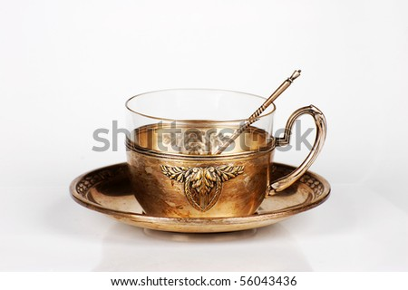 Silver antique teacup and saucer - stock photo