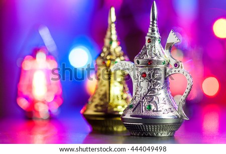 Silver Arabic Coffee Pot in colorful background. Ramadan Eid Mubarak concept background.