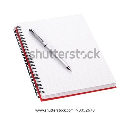 Silver ballpoint pen on open notebook - stock photo