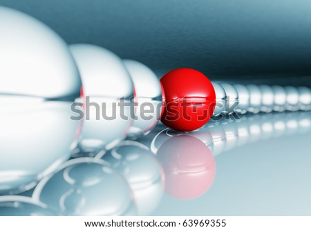 silver balls in row and red unique ball selective focus image - stock photo