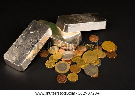 Silver bars and coins, a financial concept - stock photo