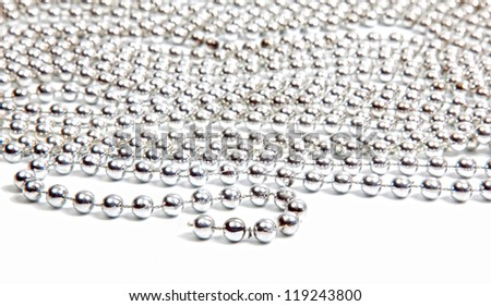 Silver beads on white background with reflection - stock photo