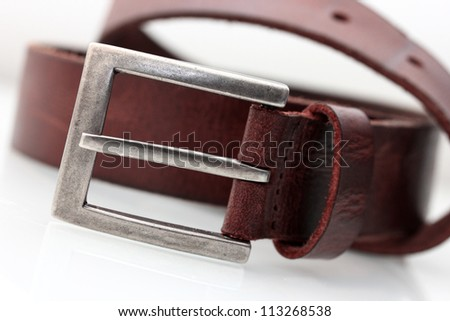 silver belt buckle close up - stock photo