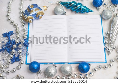 Silver-blue frame Christmas tree decorations with a notebook for notes.