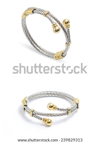silver bracelet with gold accents on a white background