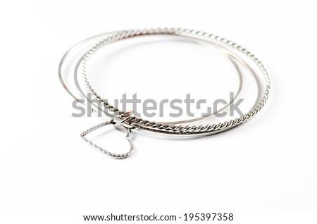 Silver bracelets isolated over white background. - stock photo