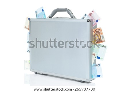 Silver brief case packed full of money and Euro bills coming out of it.  - stock photo