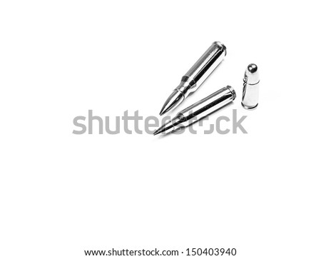 Silver 7.62, 5.56 bullets lying down and 9mm bullet standing up on white background - stock photo