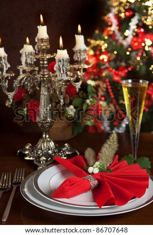 Silver candlestick in front of a blurred christmas tree