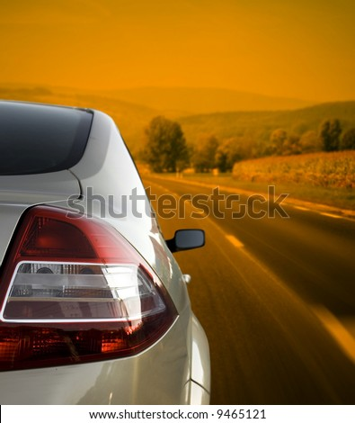 Silver car on the road - stock photo