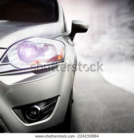 silver car without a trade brand and landscape  - stock photo