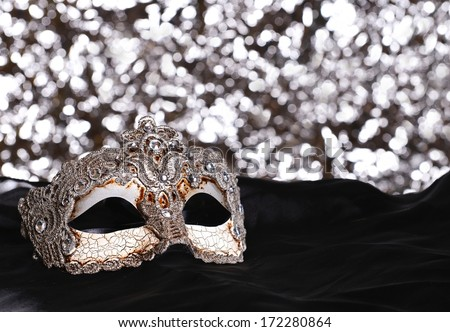 Silver carnival mask on bokeh background - stock photo