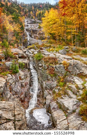 Silver cascade falls in New Hampshire, fall foliage. - stock photo