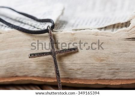 Silver christian cross on bible. Religious concept. - stock photo