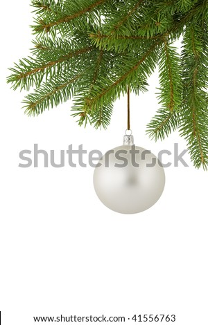 Silver Christmas ball hanging on a spruce twig. - stock photo