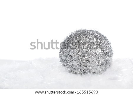 Silver Christmas ball on snow isolated on white background with copy-space - stock photo