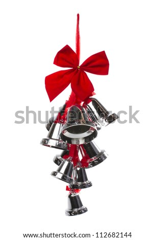 Silver christmas bells and red bow on a white background - stock photo