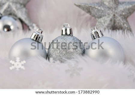 silver christmas decoration with fake snow made of white fur