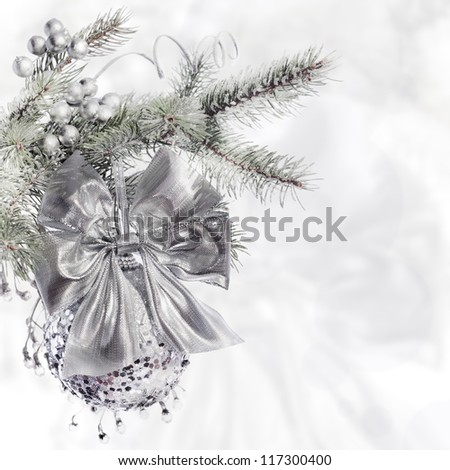 Silver Christmas decorations on abstract background - stock photo