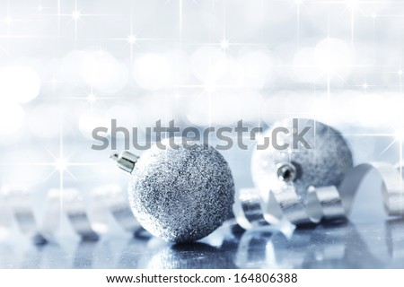 Silver christmas decorative balls on shiny stars background