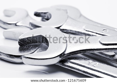 silver chrome-plated wrench spanner, close-up