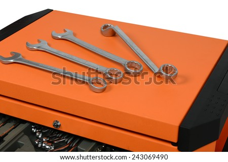 silver chrome-plated wrench spanner, close-up on tool cabinets - stock photo
