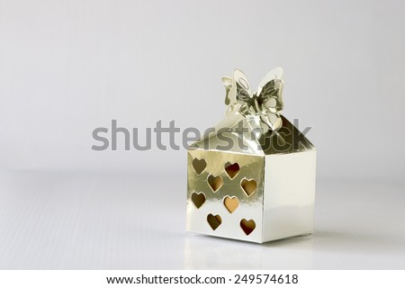 Silver color small square gift box. Used for putting hard boiled egg to be given to guest during a Malay Wedding. - stock photo