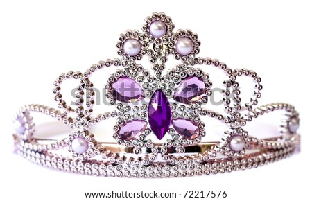 Silver color tiara with purple and lilac stones and pearls isolated on white background