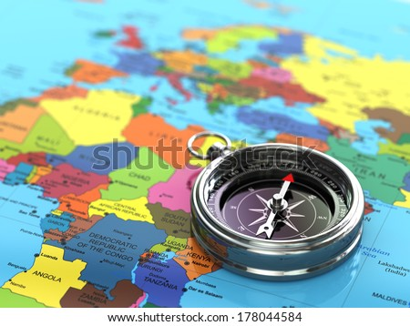 Silver compass  on world map background. 3d - stock photo