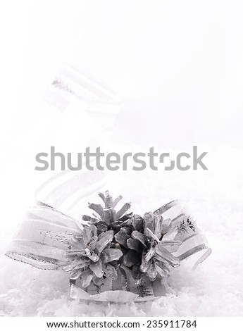 Silver cones with ribbon on snow  - stock photo