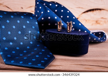 silver cuff links and red bow tie  - stock photo