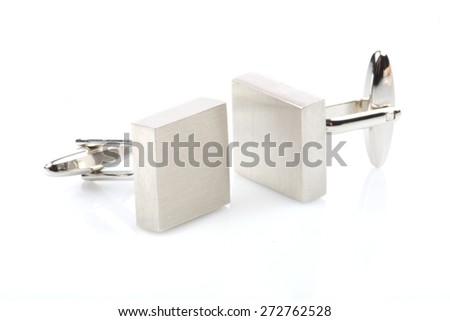 Silver cuff links on white background - stock photo