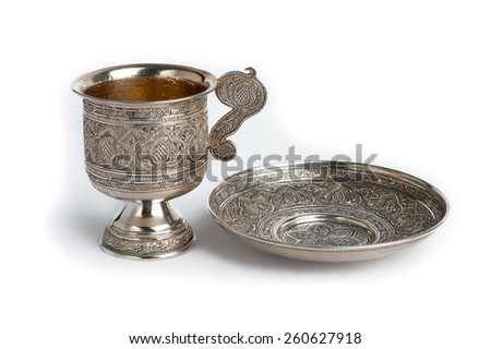 Silver cup and saucer isolated on white background  - stock photo