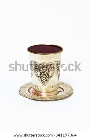 Silver cup with red wine - stock photo