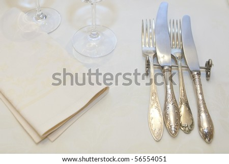 silver cutlery placed on the table - stock photo