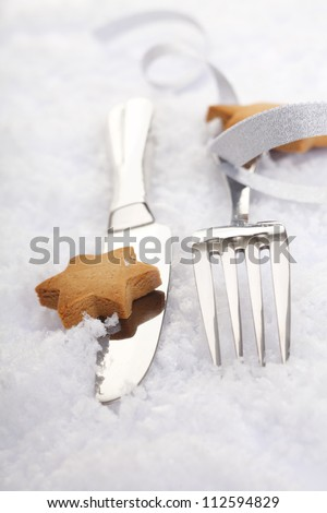 Silver Cutlery with a bow and cookies for christmas party and festive celebration events