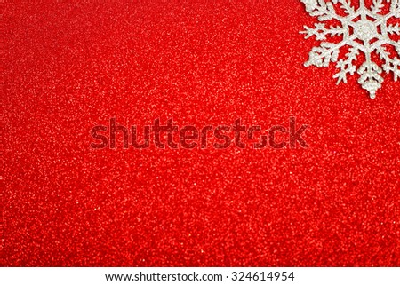 Silver decorative snowflakes on red glitter christmas background - stock photo