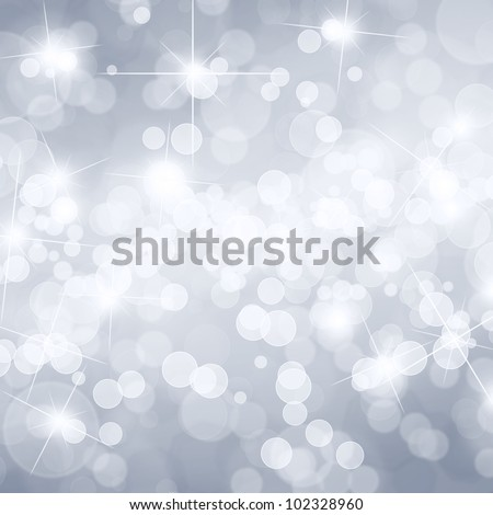 Silver defocused lights background with copy space - stock photo