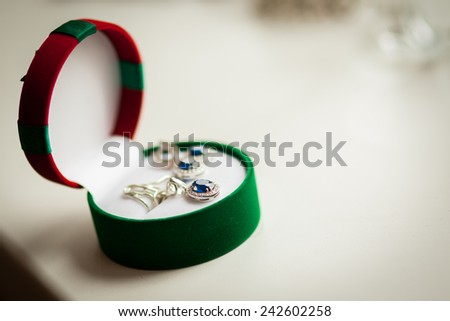 Silver earrings in a box - stock photo