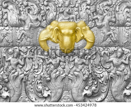 silver elephant head the gold with other animal carve artistic from Thai painting & literature wall for background or wallpaper (General art Thai Temple) - stock photo