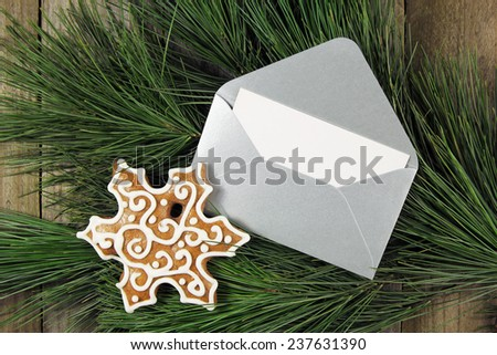silver envelope with gingerbread on christmas fir tree - stock photo