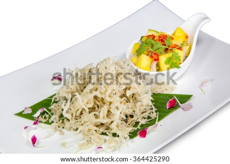 Silver fish with spicy salad isolated on white background (with clipping path)