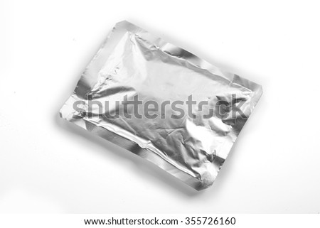 Silver foil packaging - stock photo