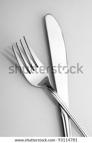 Silver fork and knife isolated on white - stock photo