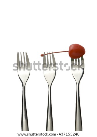 Silver fork with cherry on white background. - stock photo