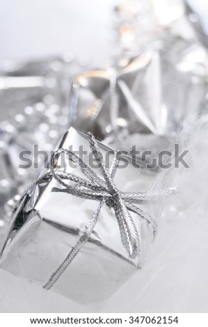Silver gift box on white blur background for merry christmas