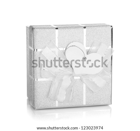 Silver gift box with bow and heart label. Isolated on white background - stock photo