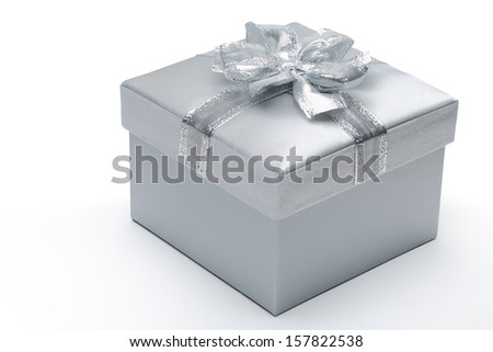 Silver gift box with bow over white - stock photo