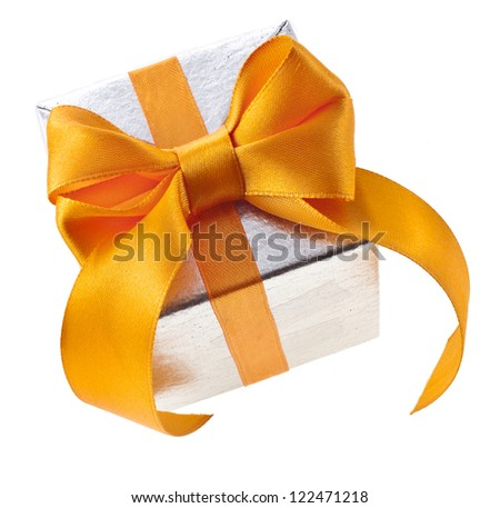 silver gift box with golden ribbon bow, isolated on white background